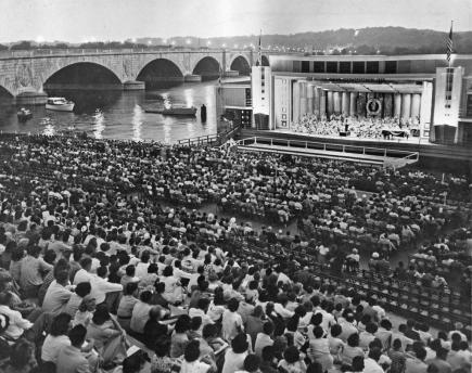 "Crowd on ""Watergate"" steps watching performance on barge at edge of Potomac River (ca. 1956). Burdell Wright, Jr. Photograph Collection"