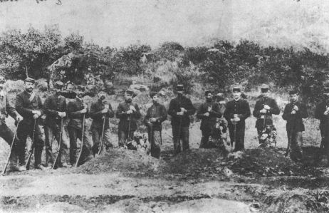 Company of Provisional Government troops burying the three soldiers killed by Ko'olau in the Kalalau Valley.