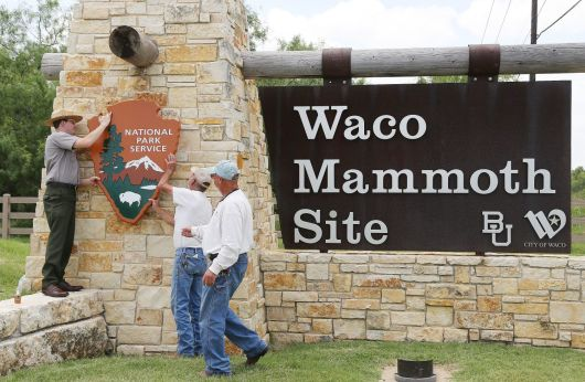 A national park service sign is put up at the Waco Mammoth Site after it becomes a national monument